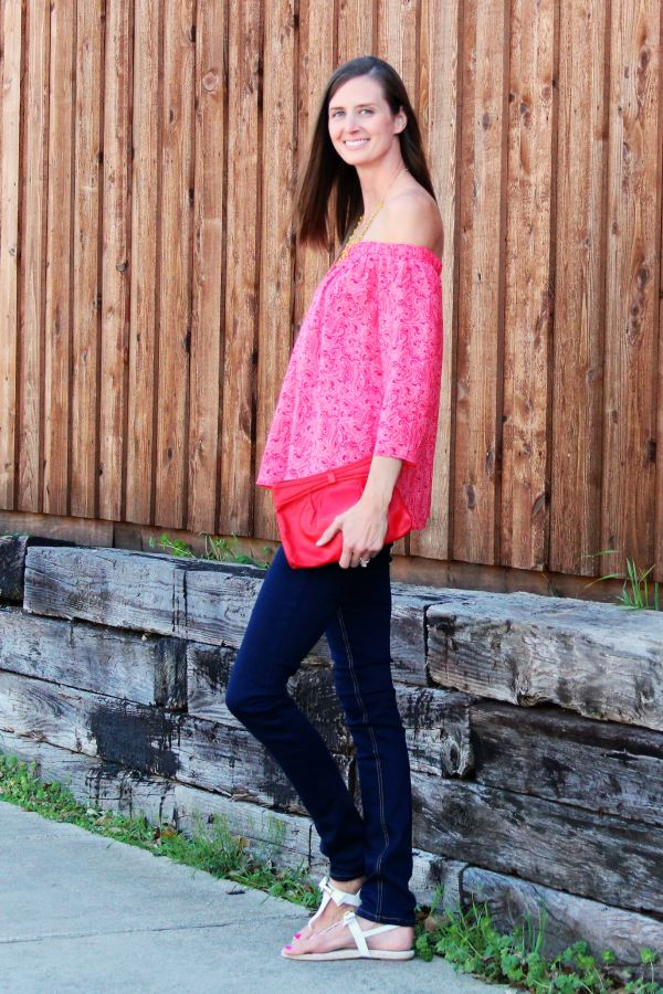 Side view of this red open-shoulder top.