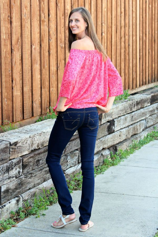 Tall off-shoulder top with dark blue jeans in a 35